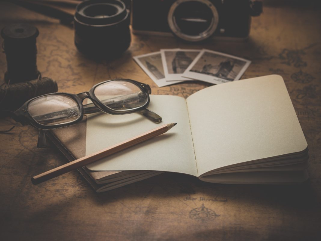 A notebook and a pair of glasses